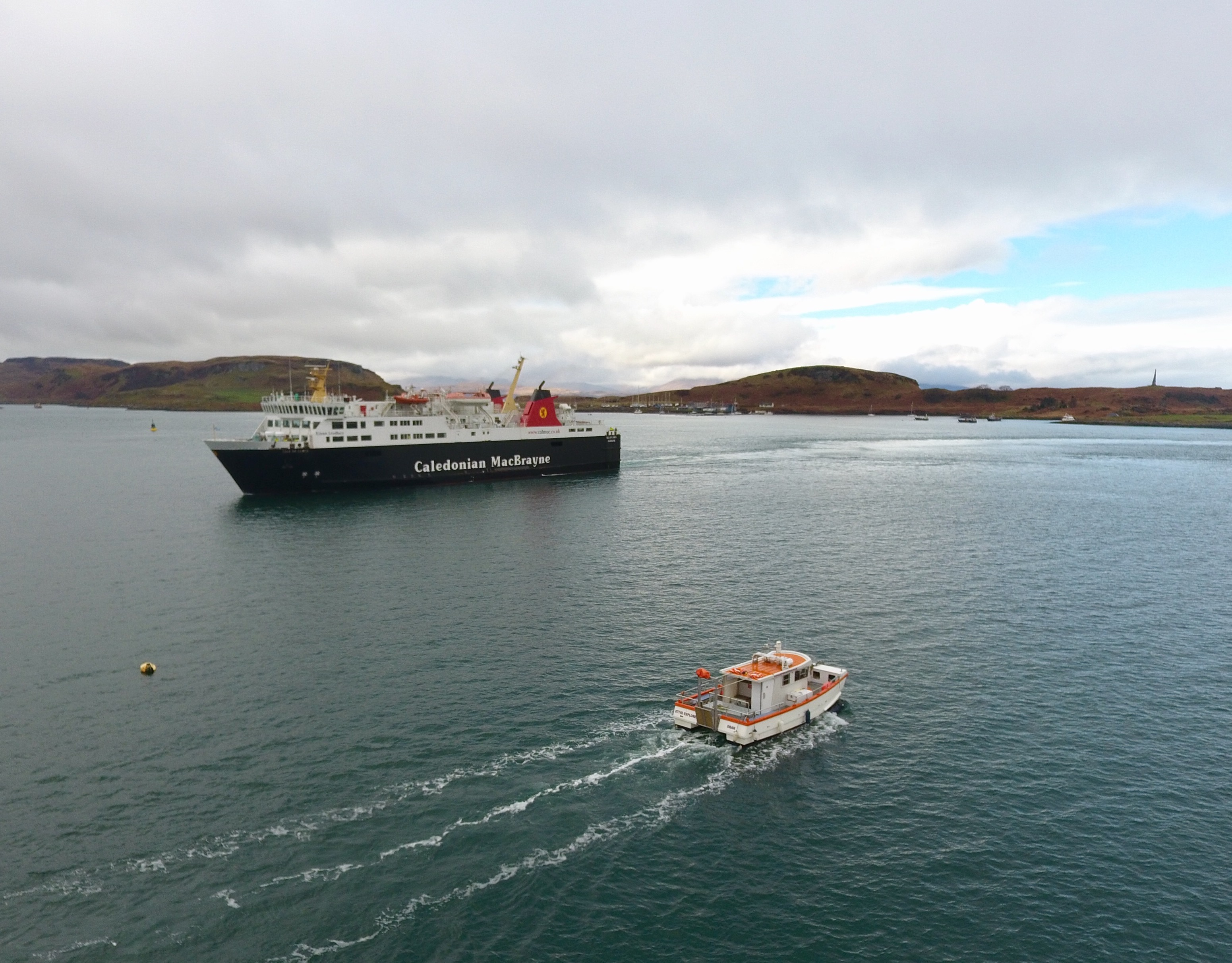 Etive Explorer cruising out of Oban Bay past the Isle of Mull Ferry